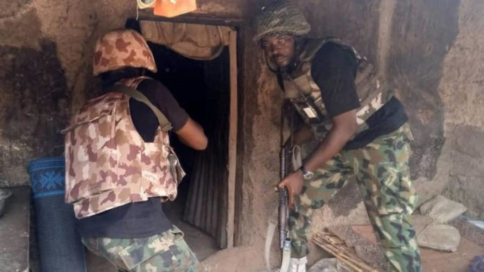 Troops of the Nigerian Army during a raid on bandits' hideout in Katsina state.
